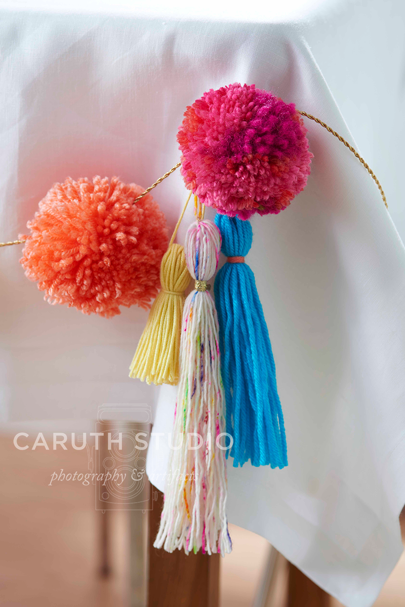 Garland with pom-poms and tassels