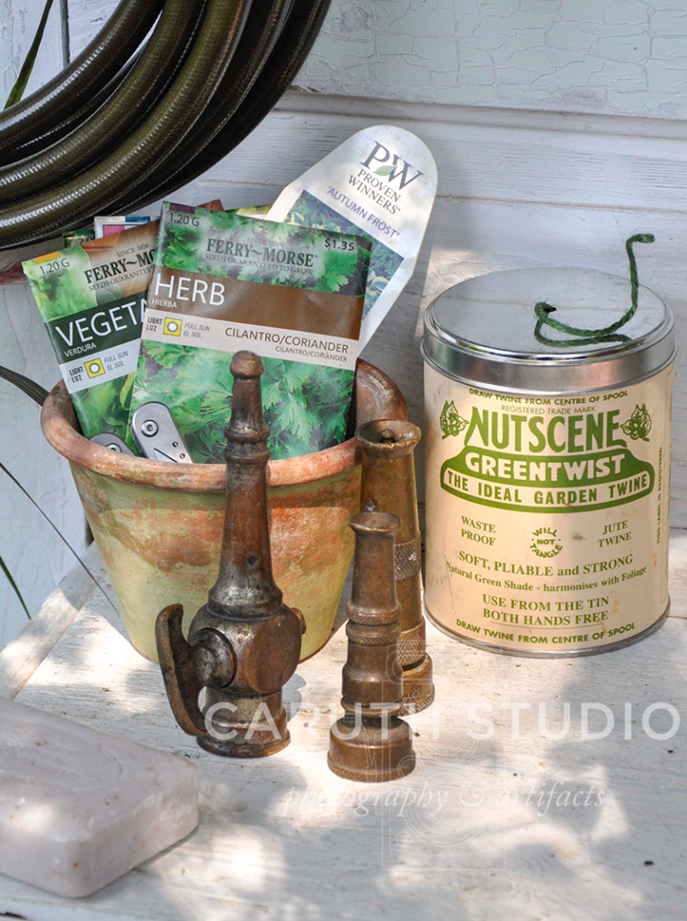 vintage hose heads and twine can