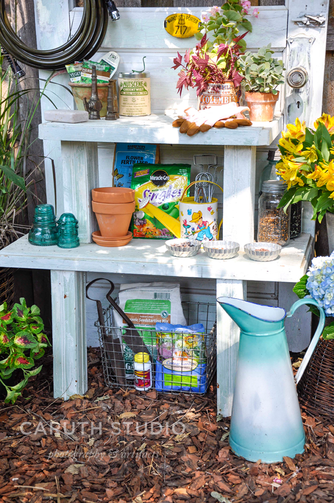 door potting bench storage shelves with planting supplies and watering can