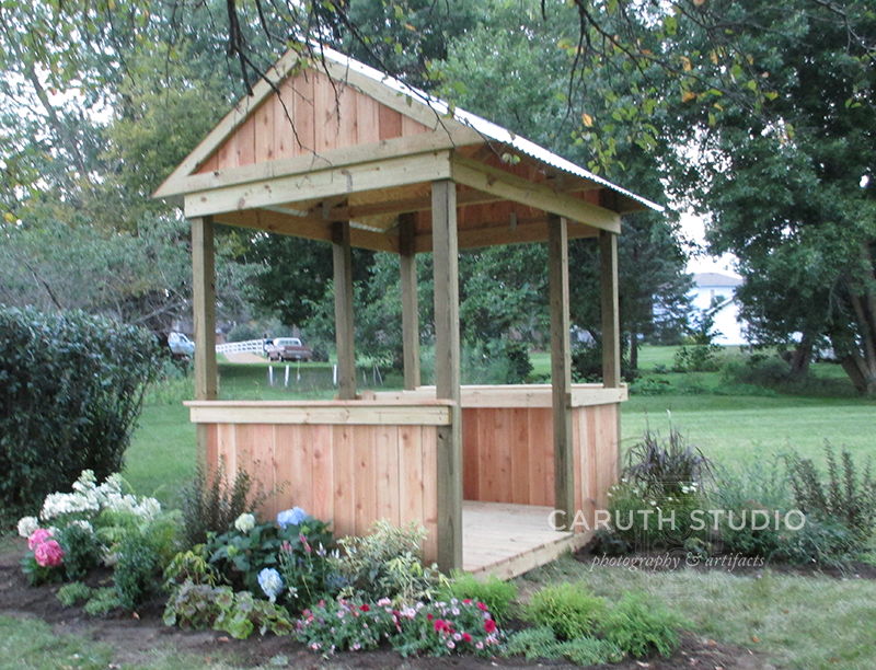 Potting Shed with surrounding planted flower beds