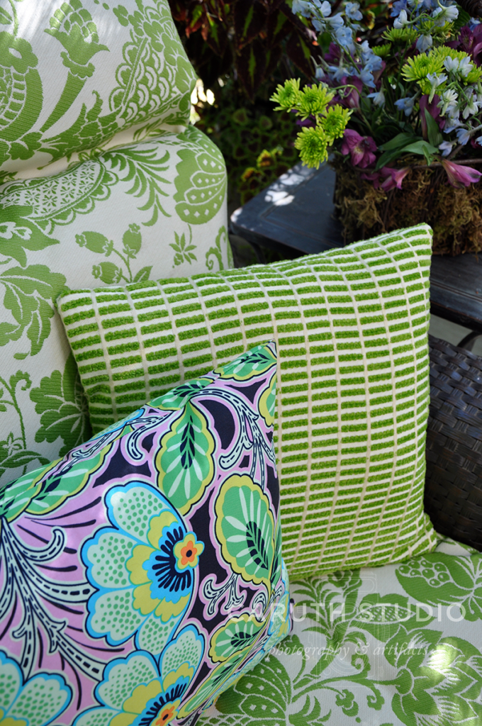 Patterned pillows in green white and cool colors