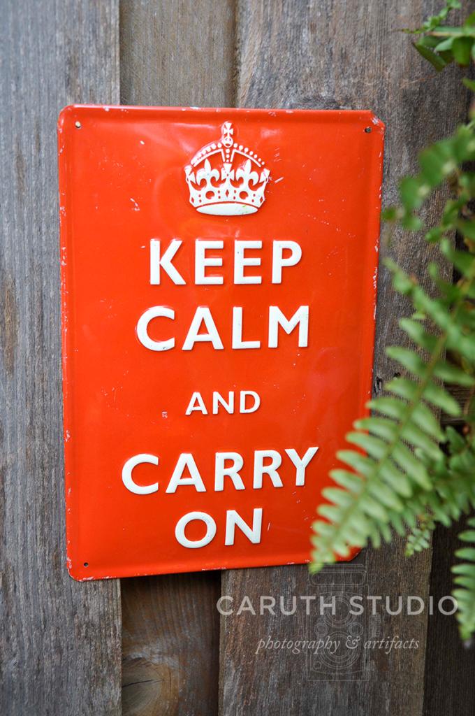 red keep calm and carry on sign