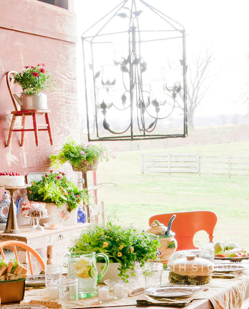Candelier over the rustic barn dining table