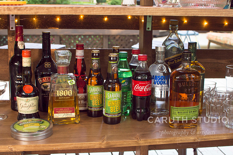 stocked drink mixers on the pallet bar