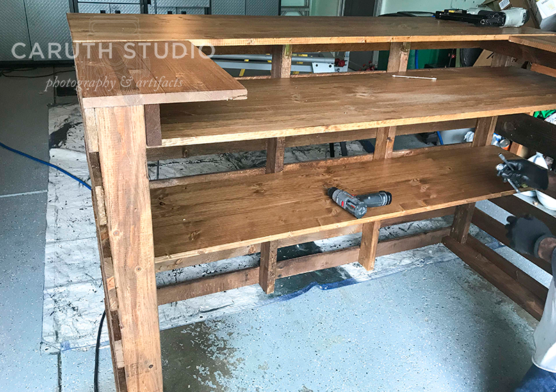 fully constructed pallet bar with two shelves and three sides