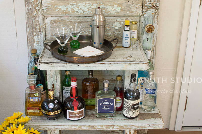 two layers of booze and a silver tray on this repurposed door bar