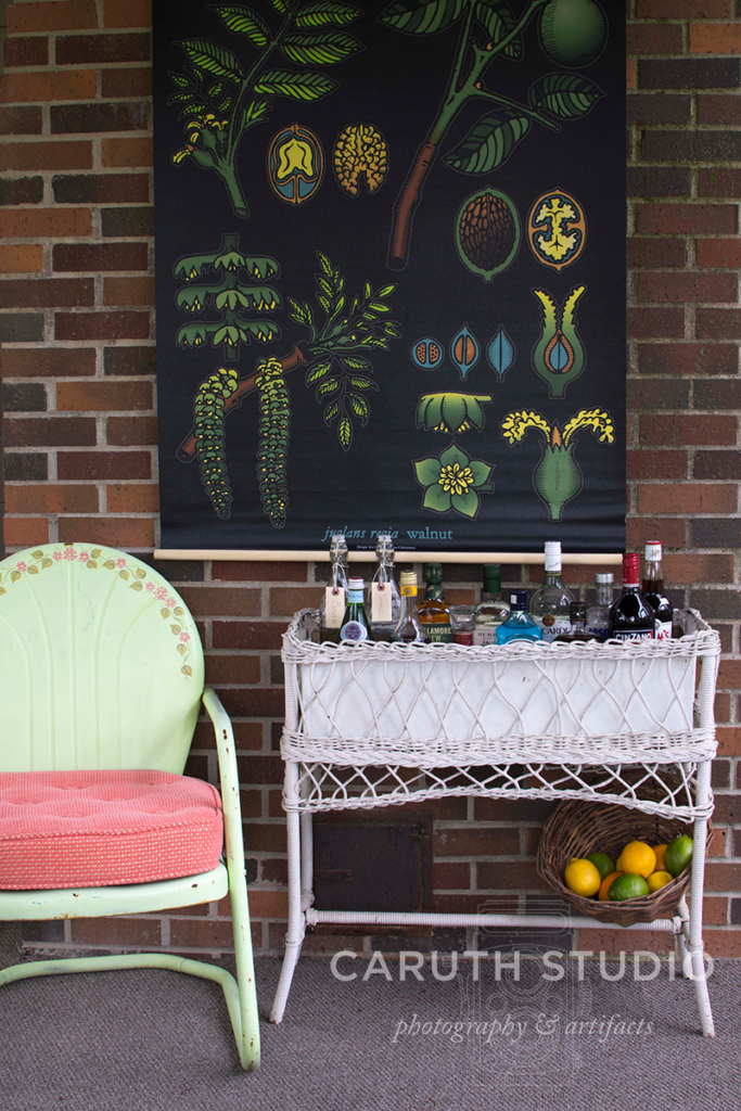 wicker bar with a basket of citrus fruits and metal deck chair