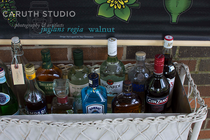 assorted alcohols in a wicker bar